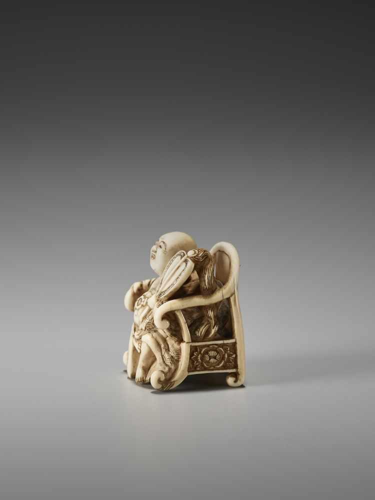 Los 31 - AN UNUSUAL IVORY NETSUKE OF HOTEI ON A THRONE BY CHIKUSAIBy Chikusai, ivory netsukeJapan, mid-19th