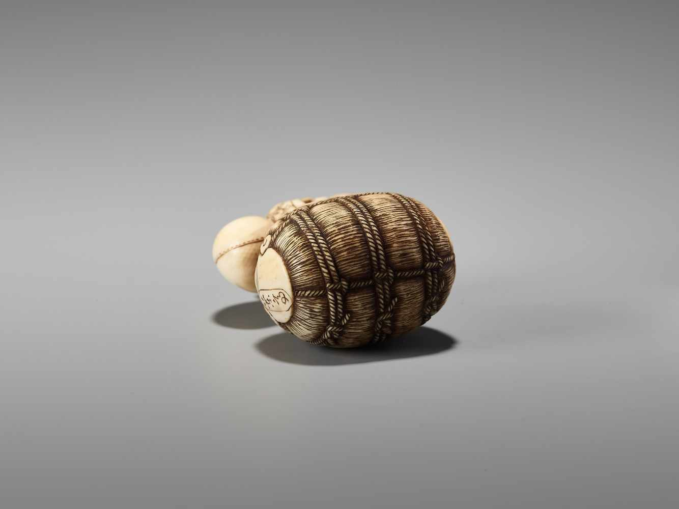 Los 38 - AN IVORY NETSUKE OF DAIKOKU ON A RICE BALE BY RANTEIBy Rantei, ivory netsukeJapan, Kyoto, mid-19th