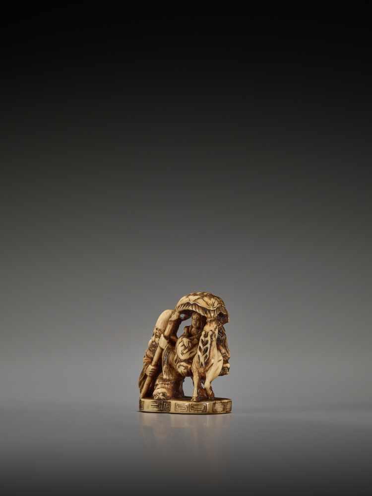 Lot 37 - A RARE IVORY NETSUKE OF JUROJIN AND BENTEN BY JORYUBy Joryu, ivory netsukeJapan, 19th century Edo