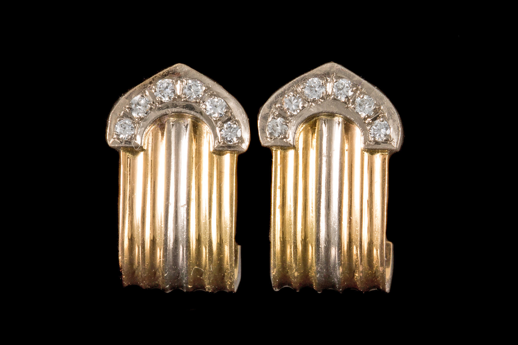 Lot 27 - A PAIR OF DIAMOND SET EARRINGS, the flut