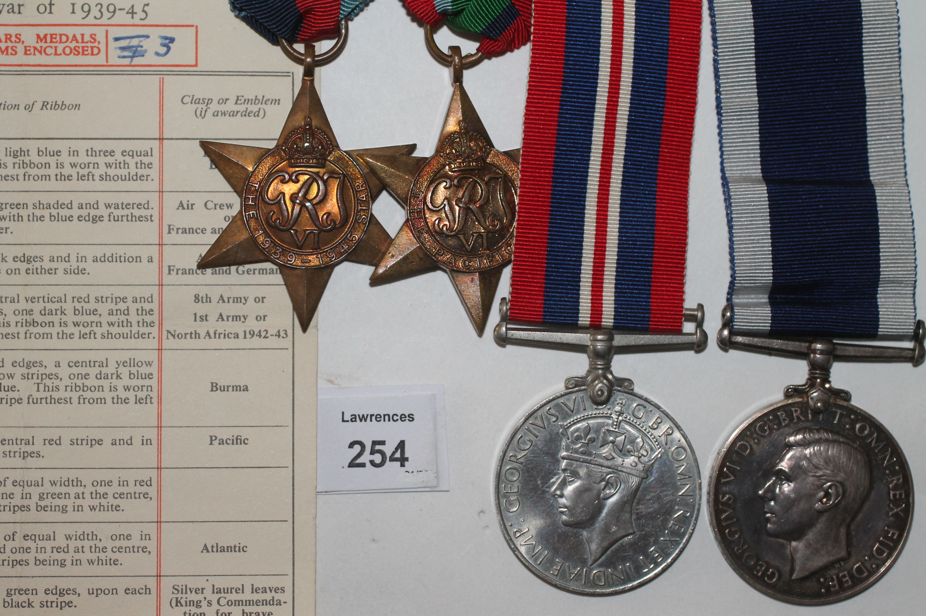Lot 254 - A PACIFIC STAR-LSGC R NAVY POW GROUP OF FOUR MEDALS. A 1939/45 & Pacific Stars, War Medal and Long