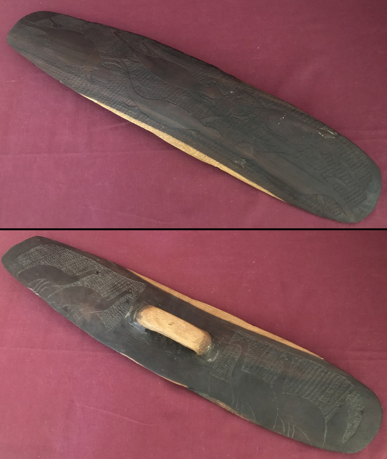 A small hand carved Mulga wood Aboriginal parrying shield.