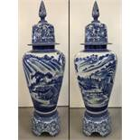 A very large Chinese blue and white ceramic lidded urn on a seperate pedestal base.