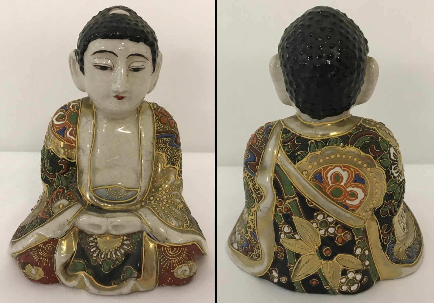 A ceramic sitting Buddha figure with gilt and hand painted floral decoration to his robe.