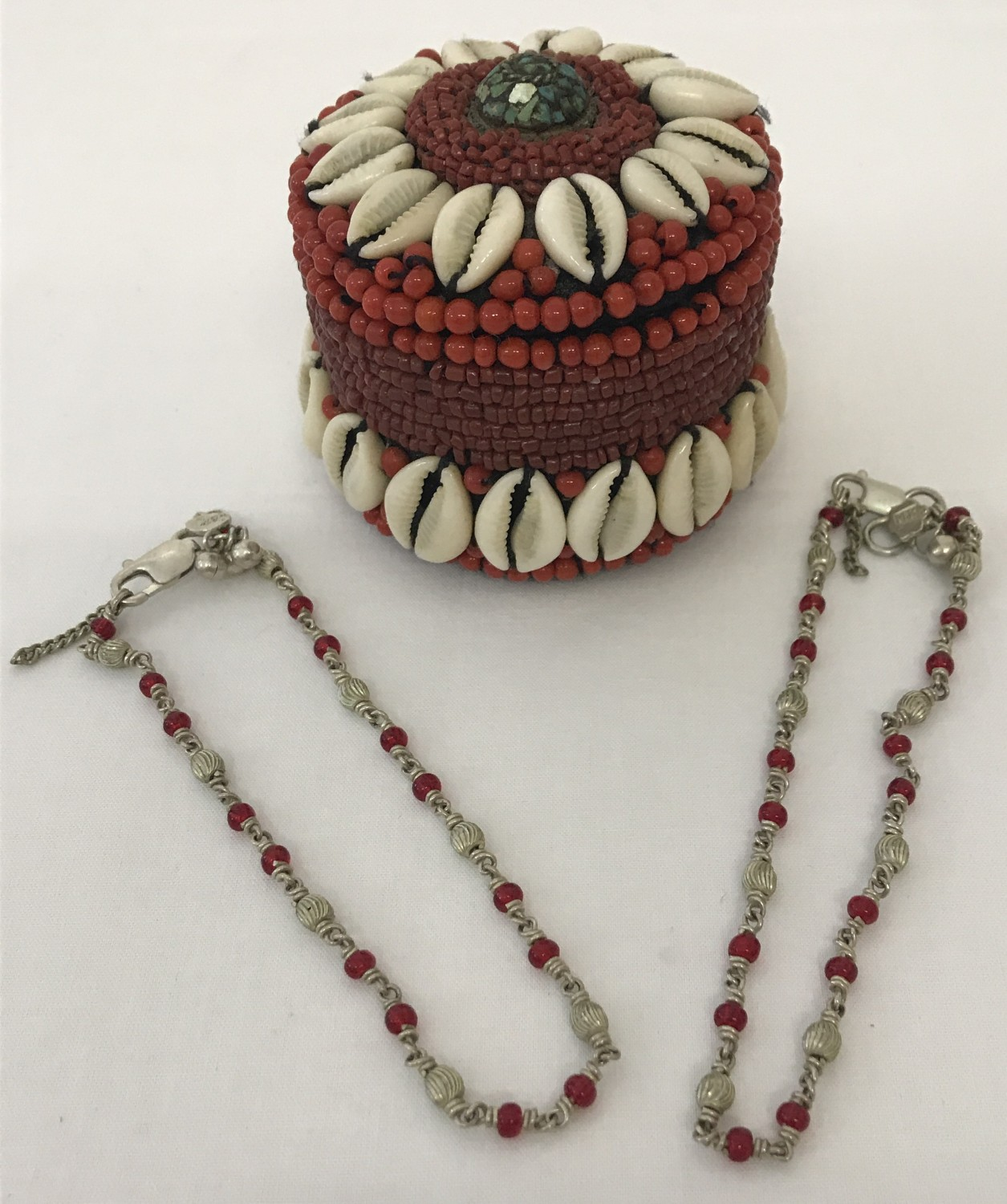 2 Indian white metal and red glass bead decorative ankle chains, both with makers marks.