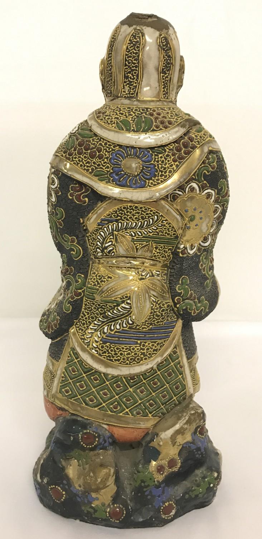 Lot 47 - A Japanese heavy ceramic divine figurine.