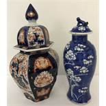 2 oriental design lidded temple jars.