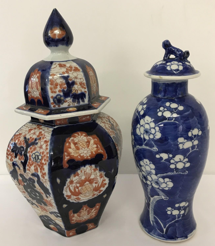Lot 39 - 2 oriental design lidded temple jars.