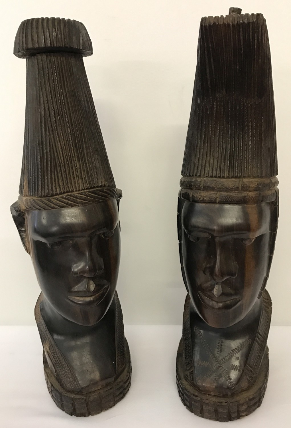 A pair of heavy solid dark wood African tribal man and woman figurines.