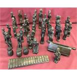 A large collection of carved dark solid wood tribal figures.