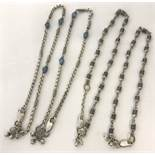 4 Indian white metal and bead ankle chains with bells.