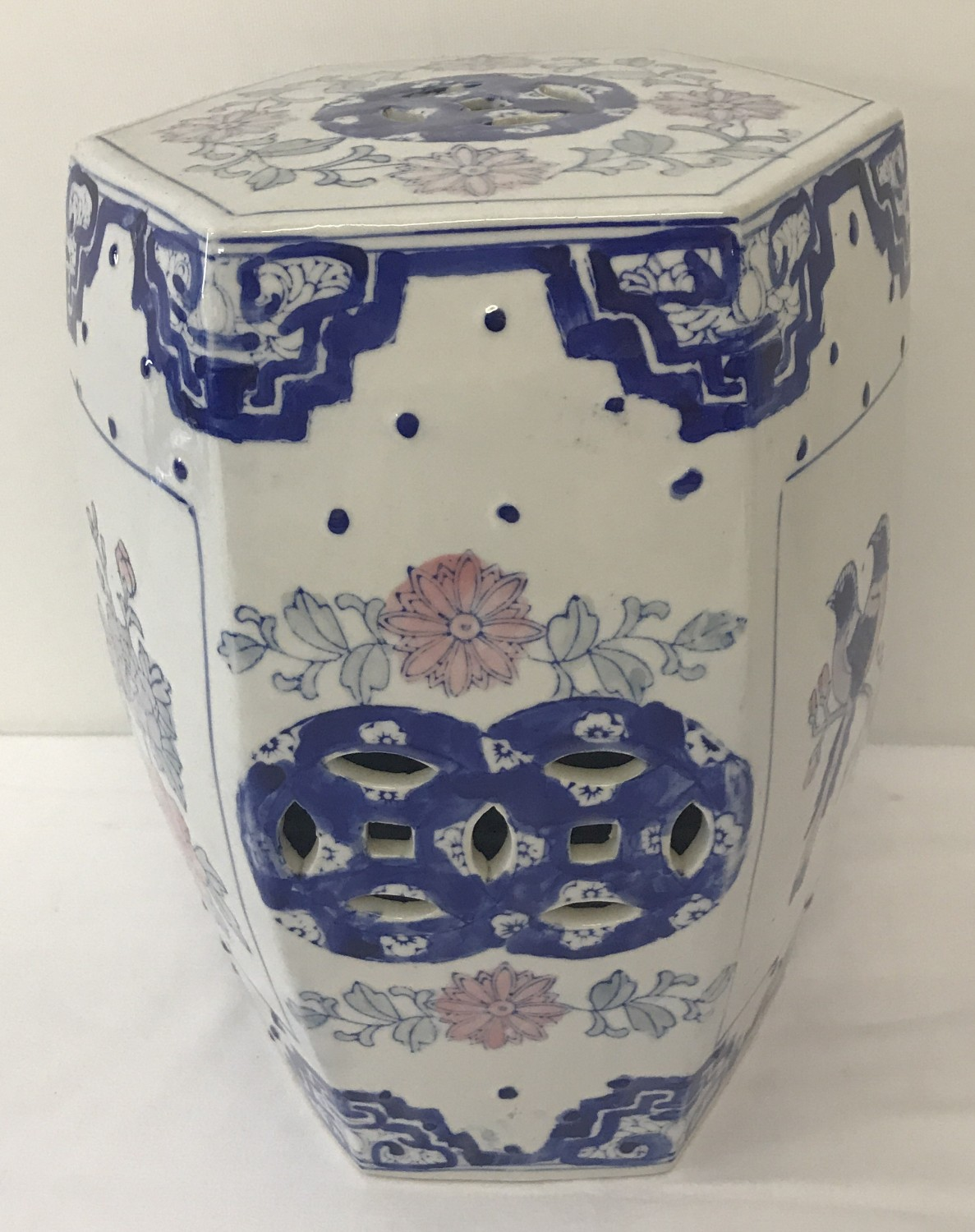 A Chinese hexagonal ceramic stool with pierced detail to sides and top.