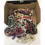 A box of vintage plastic and wooden bead necklaces.