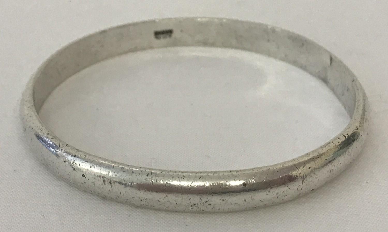 """A Zambian silver bangle. Marked """"KABWE Silver"""" to inside of bangle."""