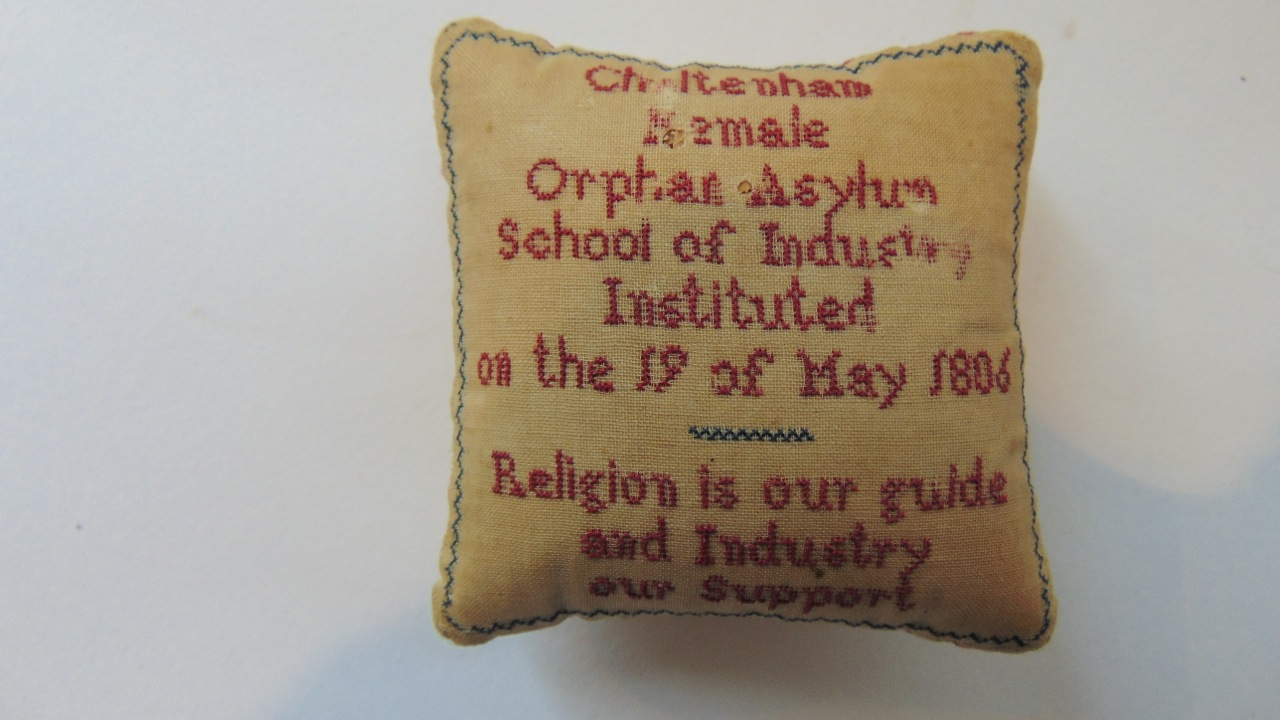 Lot 394 - An early 19th century pin cushion with sampler work detail, Cheltenham Female Orphan Asylum School