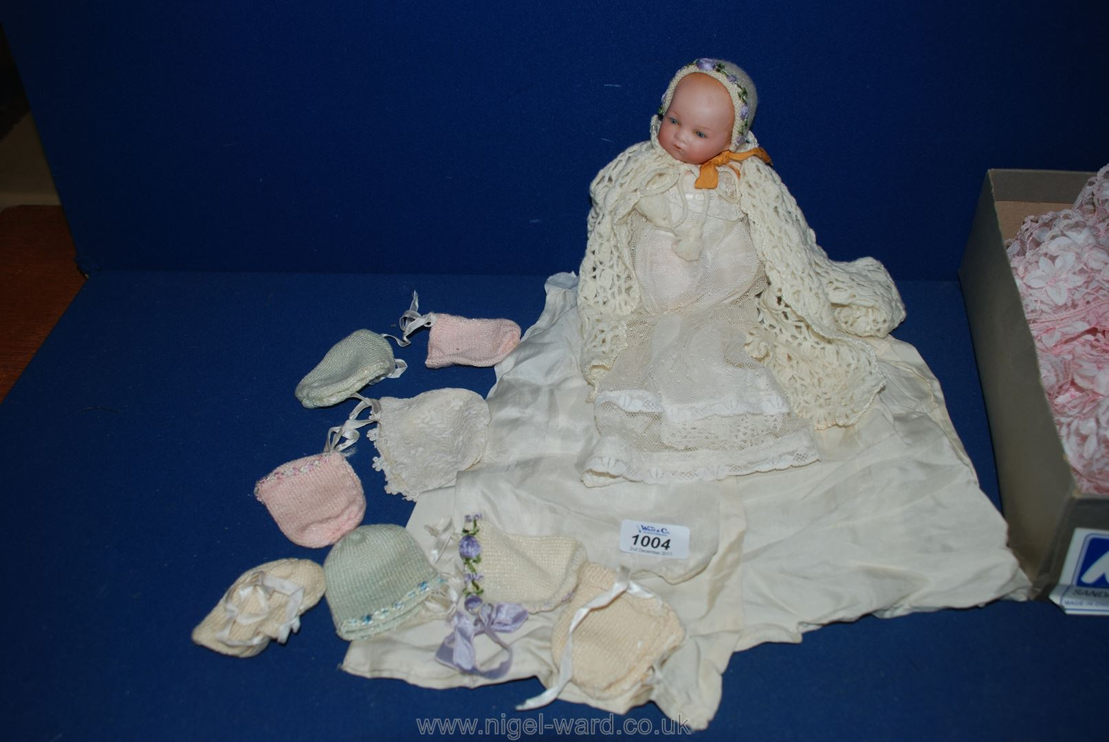 Lot 1004 - A small porcelain headed Doll, marked AM to back of neck, 8'' tall,