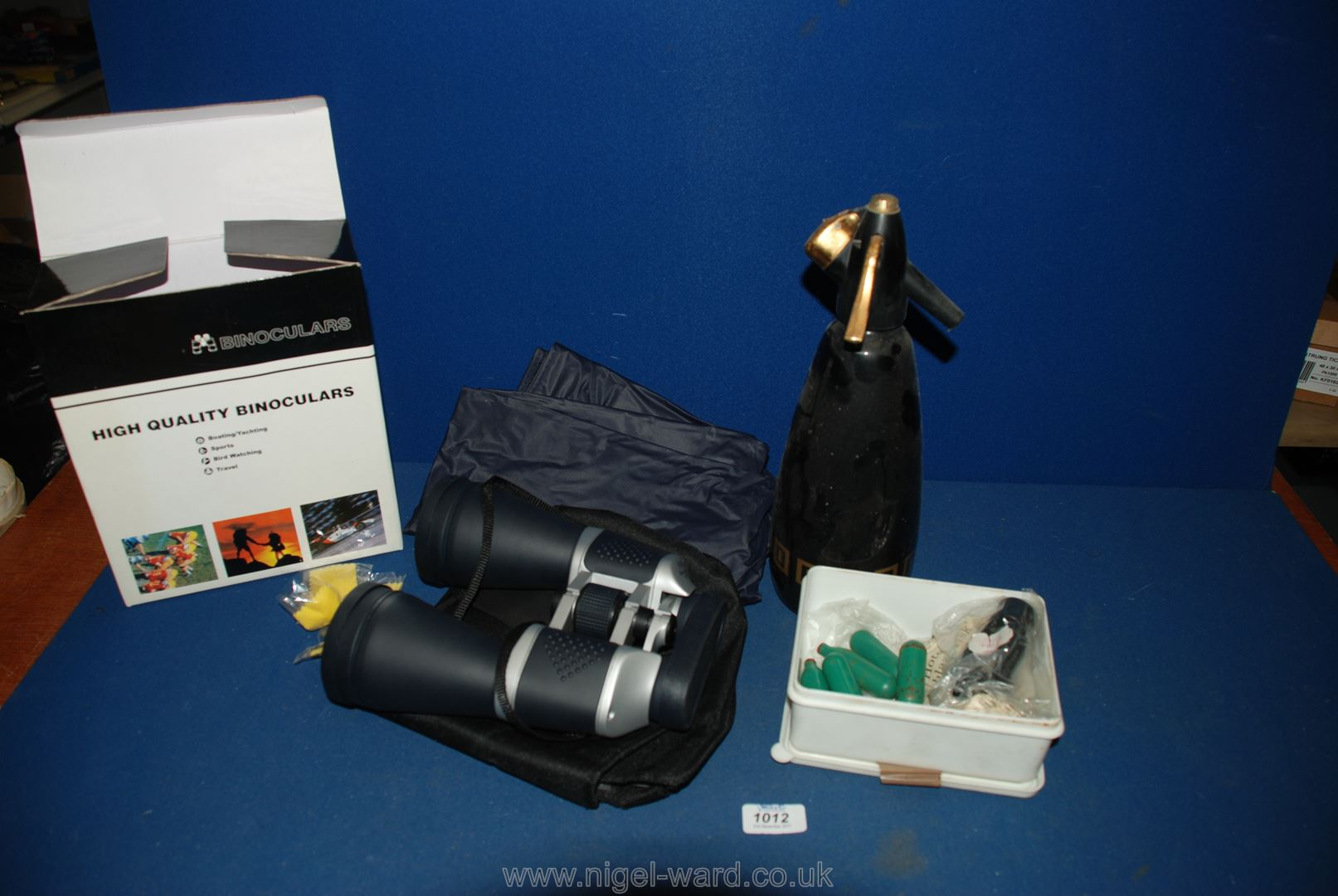 Lot 1012 - A pair of 10 x 60 Binoculars, still boxed with soft carry case,