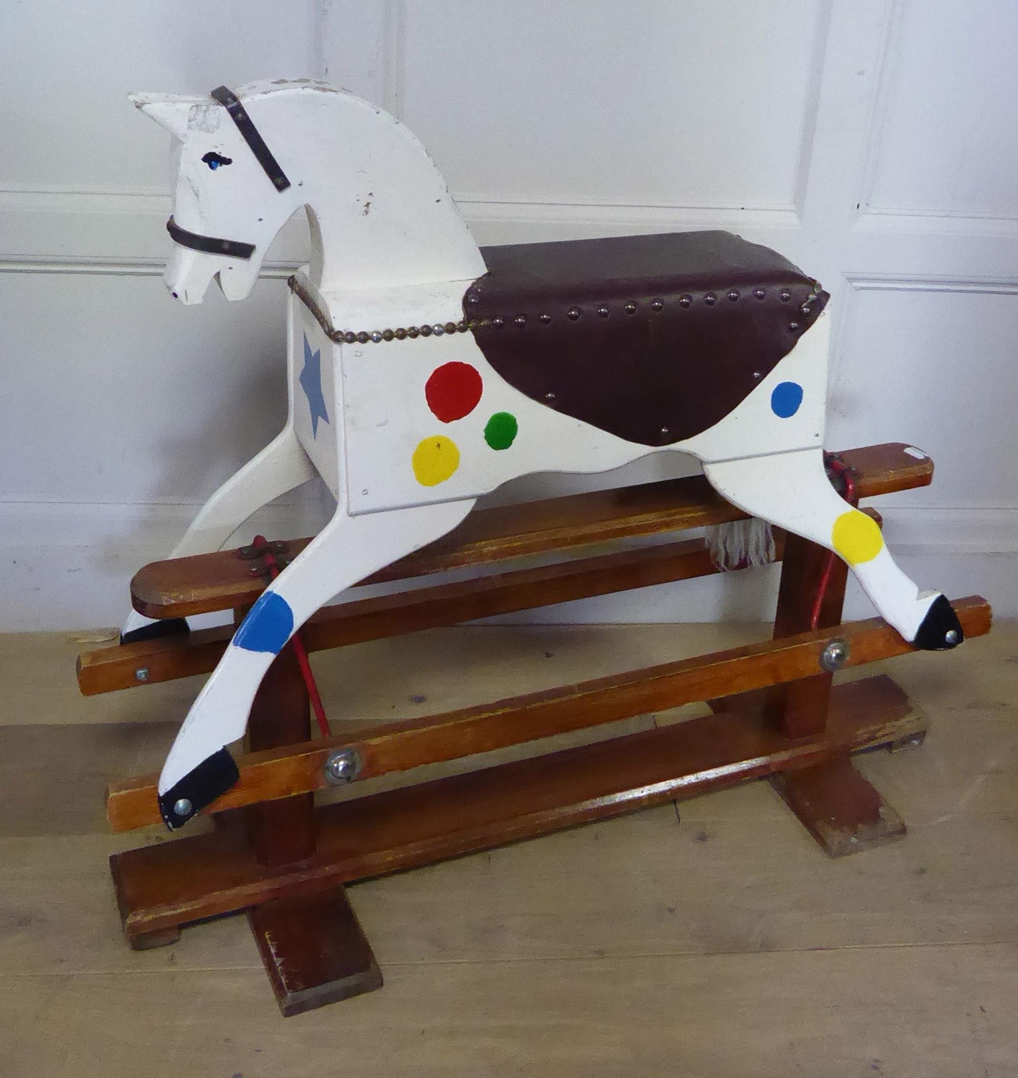 Lot 496 - A MID 20TH CENTURY CHILD?S WOODEN ROCKING HORSE. (90cm x 80cm)