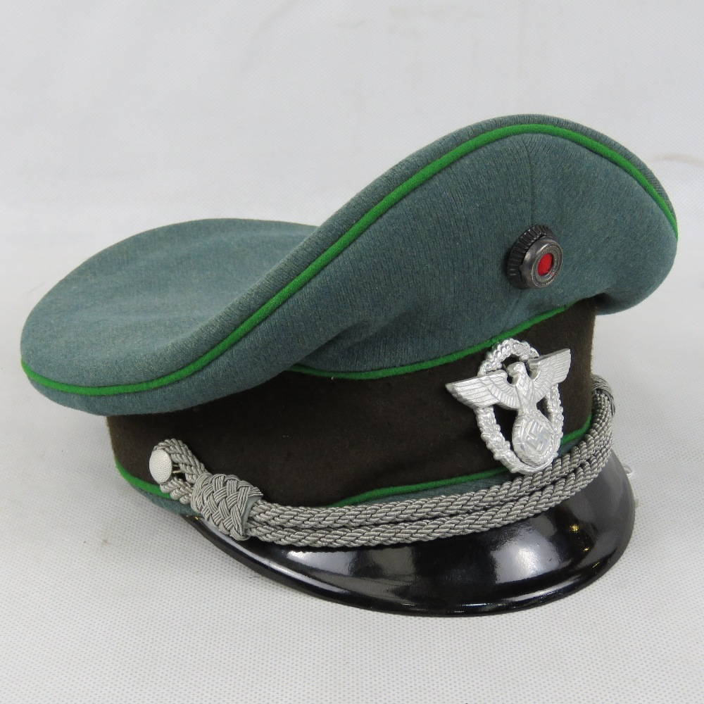 A WWII German Police Officers Peaked Cap With Makers