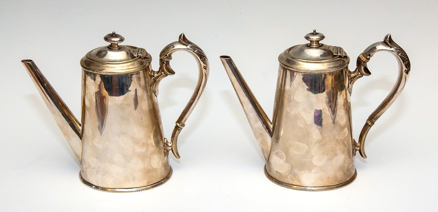 A pair of 19th Century silver plated coffee pots, of oval tapered form, finials, scroll handles,