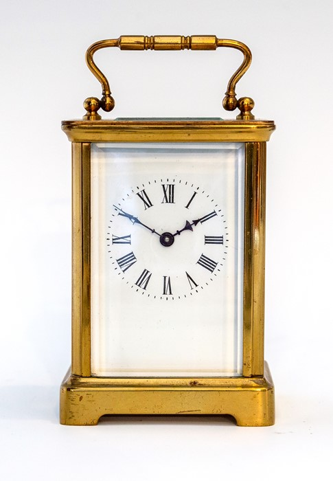 An early 20th Century carriage timepiece, brass corniche case, visible escapement, white enamel dial
