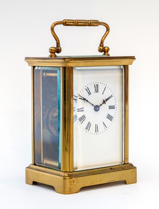 An early 20th Century carriage timepiece, brass corniche case, visible escapement, white enamel dial - Image 6 of 8