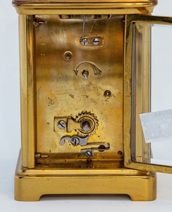 An early 20th Century carriage timepiece, brass corniche case, visible escapement, white enamel dial - Image 8 of 8