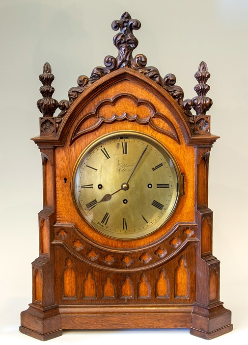 Kippax, Retford, a mid 19th Century musical oak bracket clock of Gothic Revival design, the arched