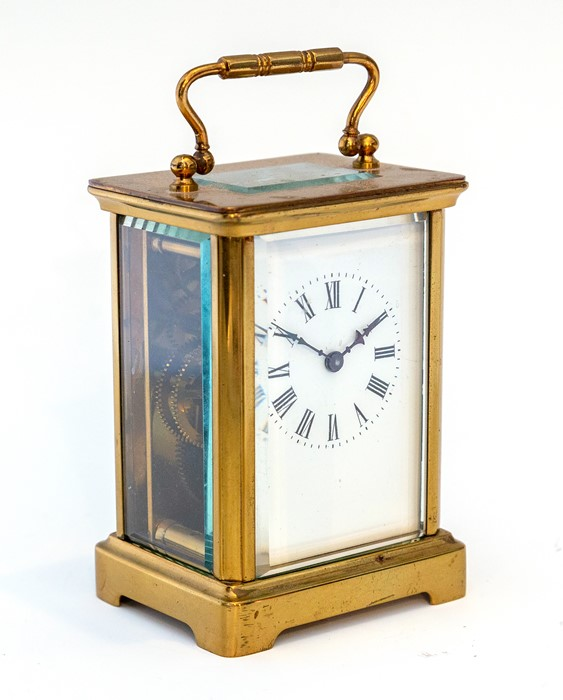 An early 20th Century carriage timepiece, brass corniche case, visible escapement, white enamel dial - Image 7 of 8