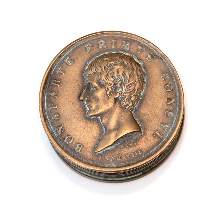 Napoleon Interest, a novelty cast metal pocket snuff box in the form a Napoleonic coin, screw top, - Image 2 of 4