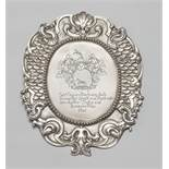 A Sinzig silver official shieldSilver. Oval cartouche form shield with chased règence décor to the