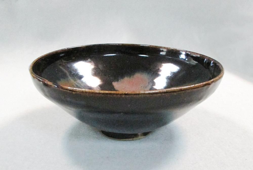 Lot 63 - A 20th century Chinese stoneware bowl, glazed in brown, 18.5cm diameter; another similar 17cm