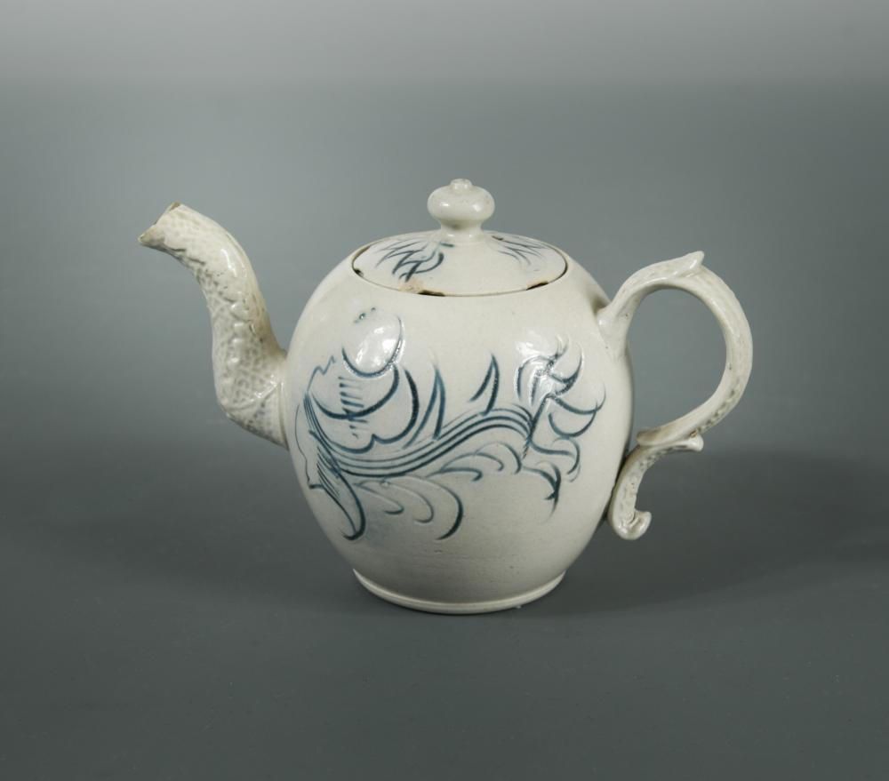 Lot 32 - An 18th century Staffordshire salt-glazed miniature teapot and cover, the globular body decorated