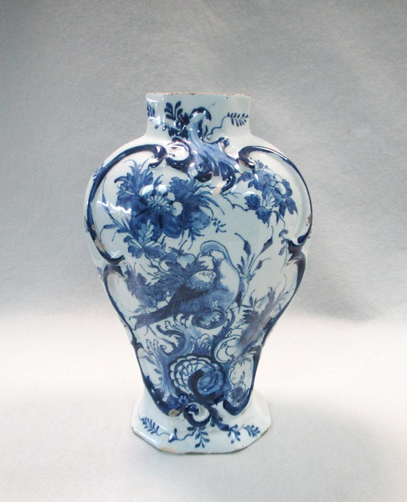 Lot 40 - An 18th century Delft blue and white vase, of fluted shouldered ovoid form, decorated with a