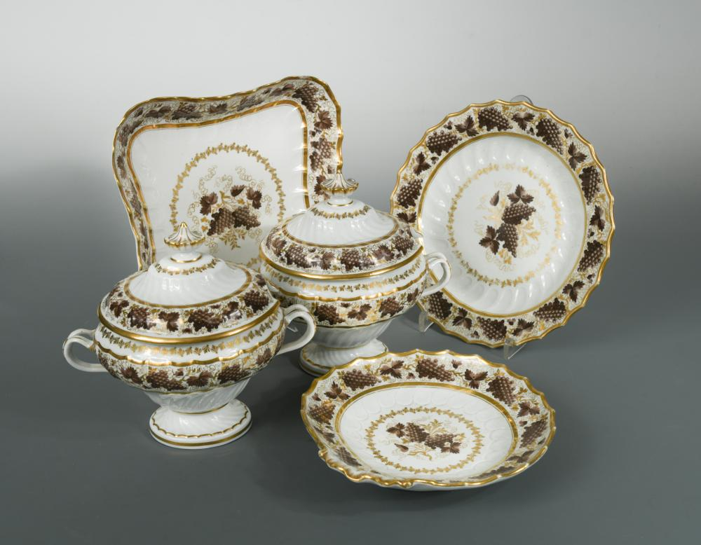 Lot 12 - A Regency English porcelain dinner service, probably Flight and Barr, decorated with borders of