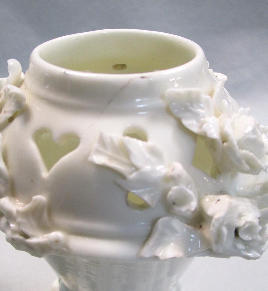 Lot 23 - A rare pair of Saint-Cloud blanc de chine pot-pourri vases, circa 1730-50, the quarter lobed