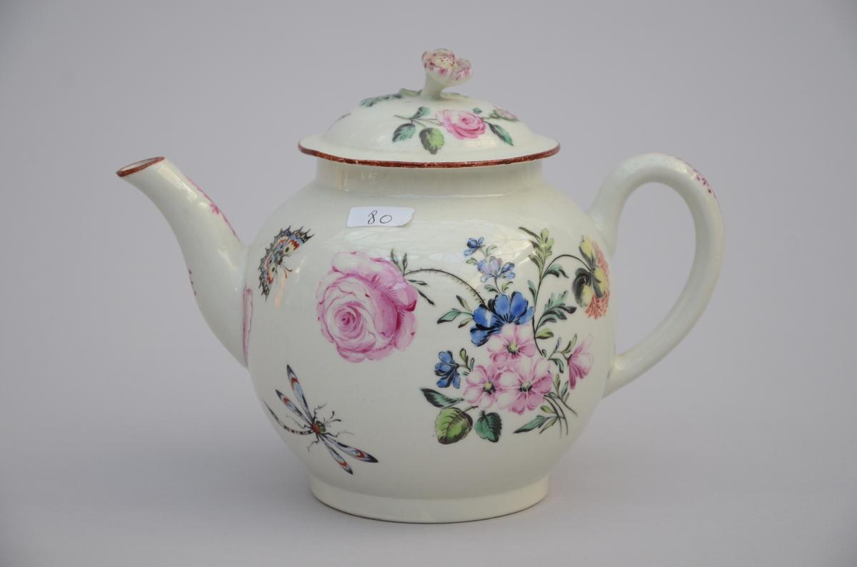 Lot 448 - A teapot in p'te tendre 'floral decor' (14cm)