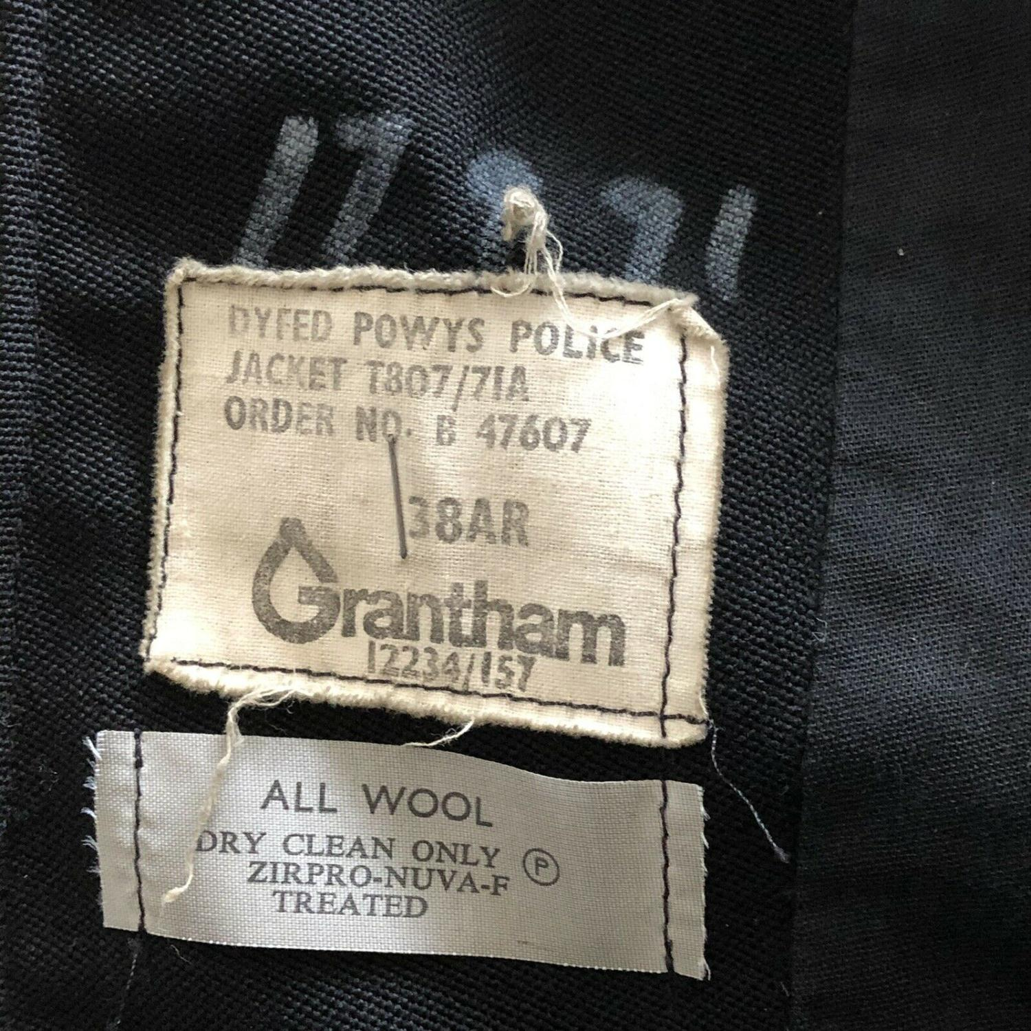 Lot 58 - A Vintage Black Police Uniform Jacket with Dyfed Powys Buttons - All Wool label