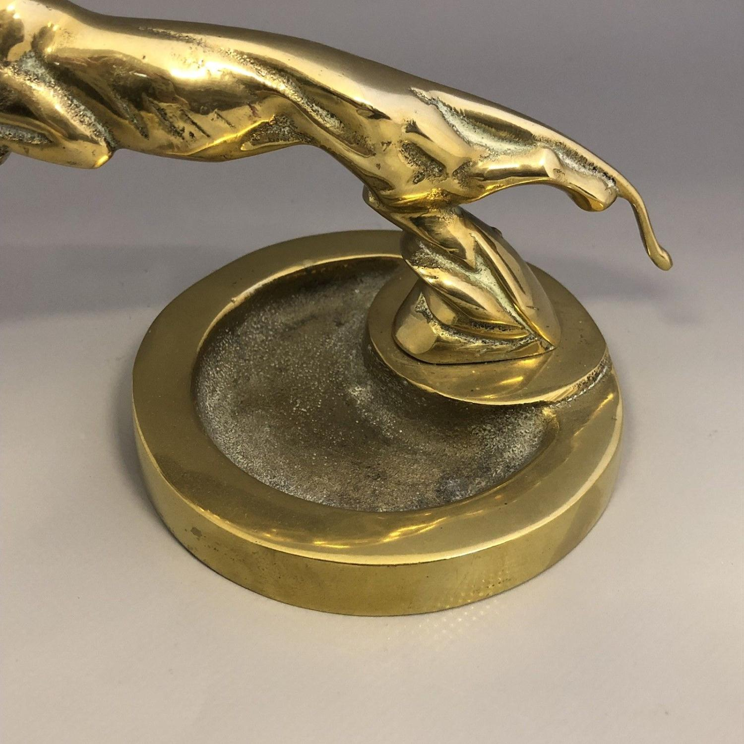 Lot 35 - Vintage cast brass ashtray with leaping jaguar mount car mascot