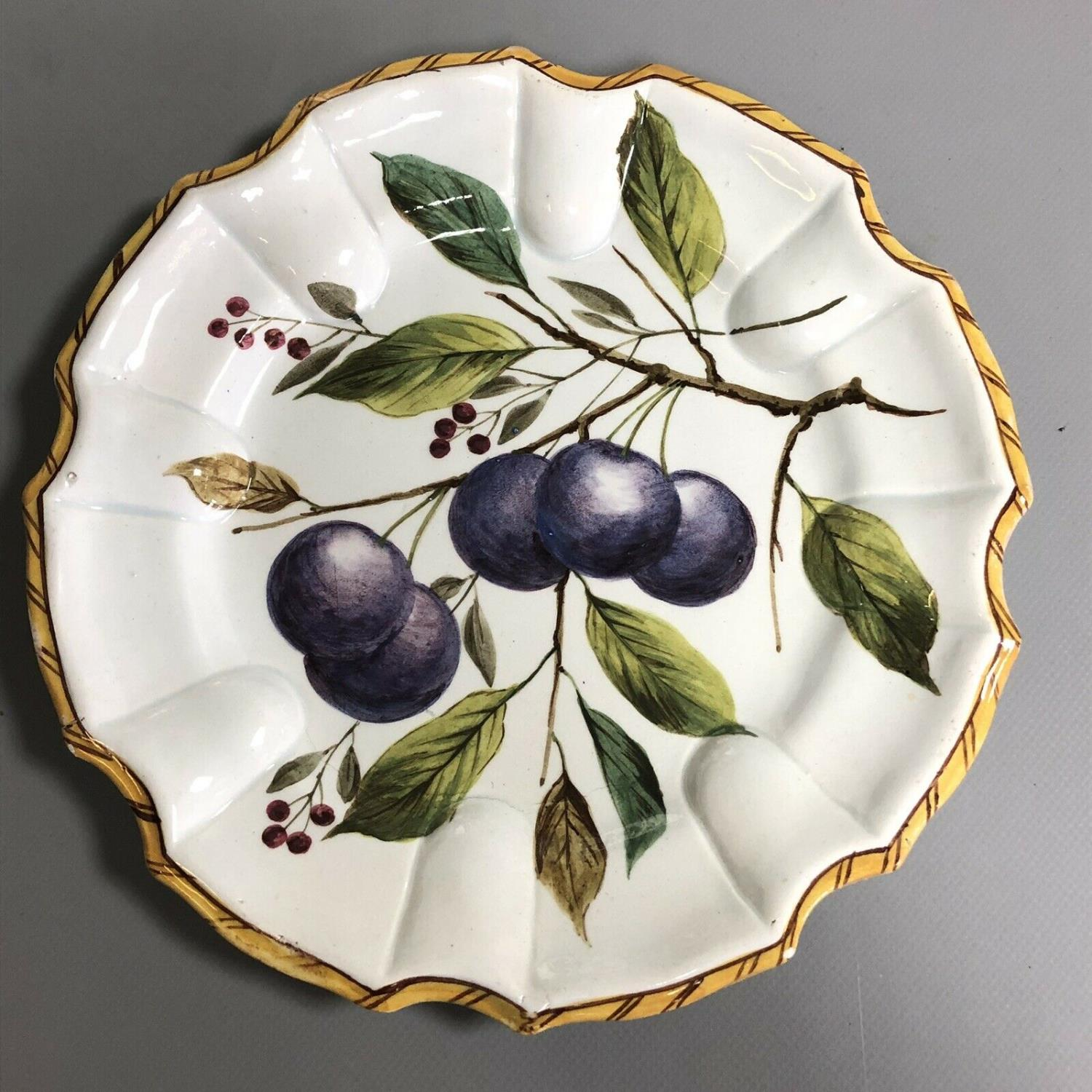 Lot 18 - A set of three antique Continental pottery plates hand painted with fruits