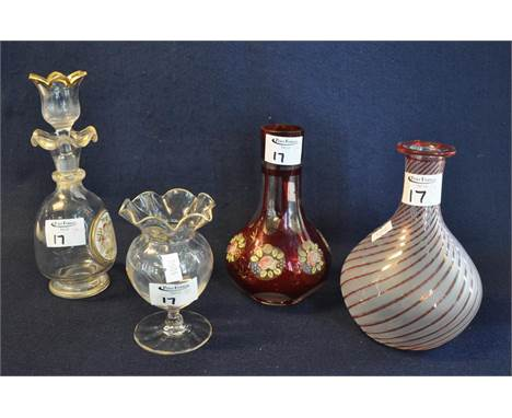 Four items of continental glass to include; ruby flash decorated baluster shaped carafe, a Venetian design wrythen carafe, a