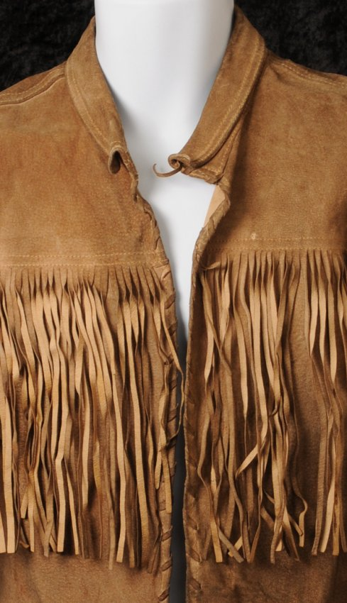The Beatles / Paul McCartney: worn and owned brown fringed leather jacket.