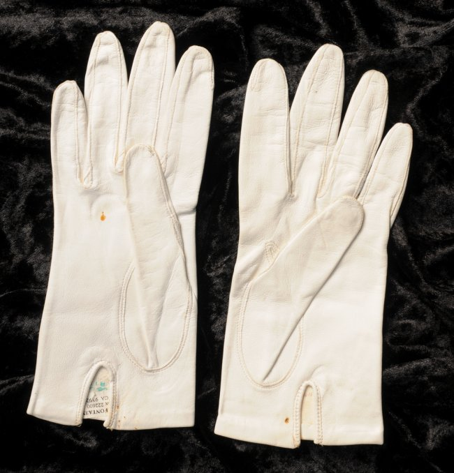 Lot 11 - Joan Fontaine (1917-2013) American Actress, pair of personally owned and worn white gloves with an