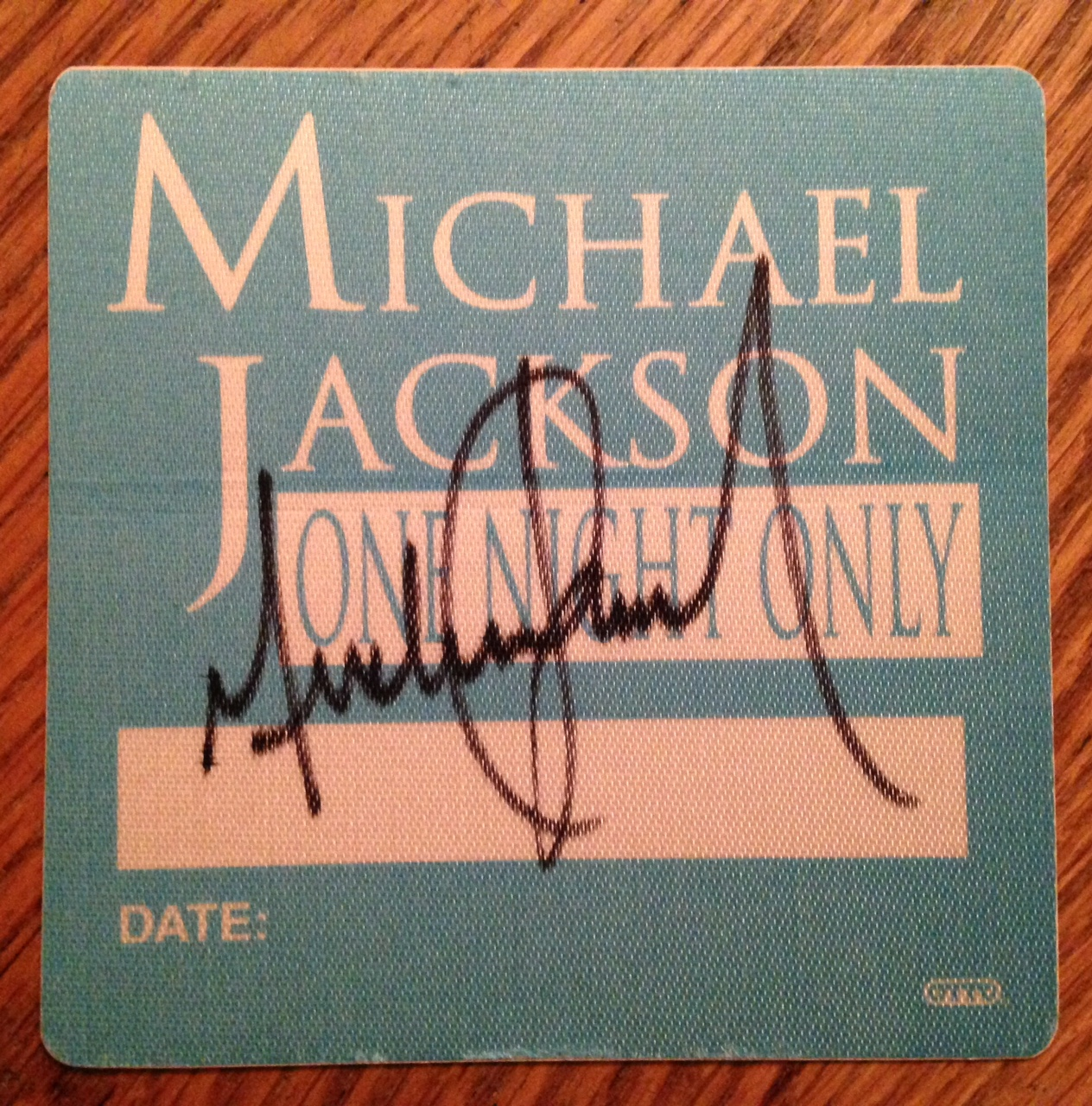 "Lot 58 - Signed Michael Jackson """"One Night Only' Backstage pass from tour."