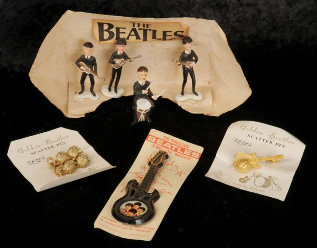Lot 1 - The Beatles: figurines, Invicta Plastics brooch & two scatter pins A set of Beatles figurines marked