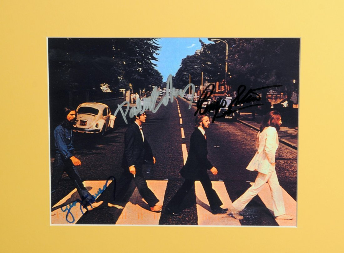 Lot 3 - The Beatles: An autographed publicity photograph, the colour photograph taken in Abbey Road signed