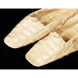 Lot 94 - Queen Victoria previously personally owned and worn pair of ivory silk slippers inscribed 'Worn by