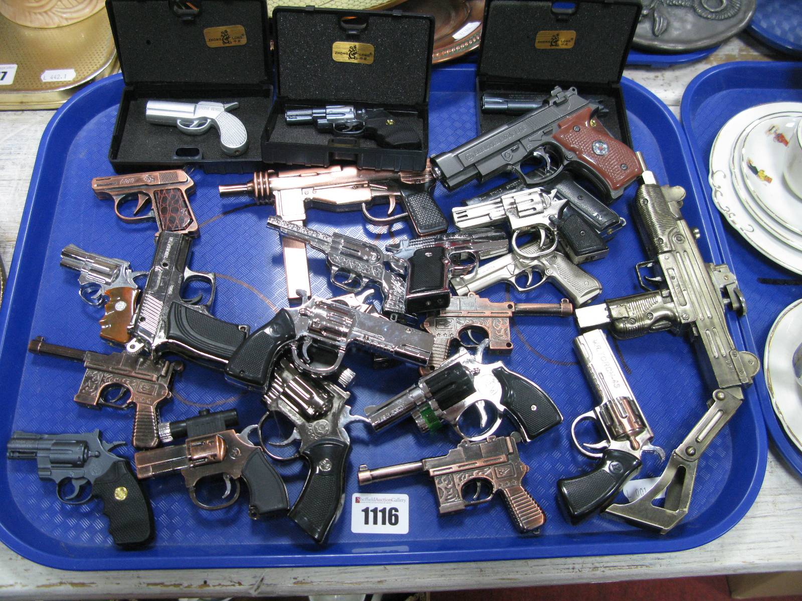 Lot 1116 - Novelty Lighters, in the form of guns, etc:- One Tray