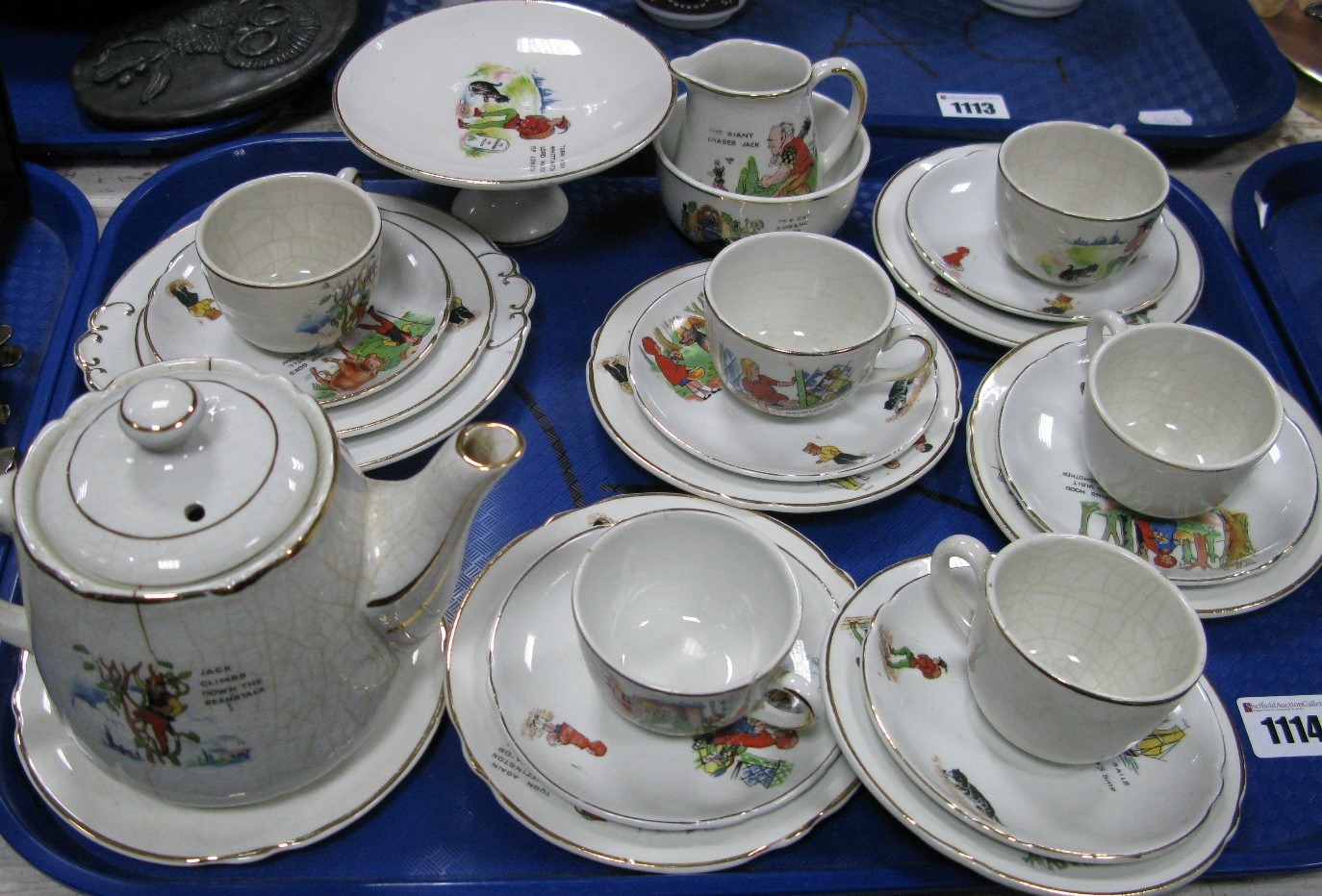 Lot 1114 - A Children's Pottery Six Place Nursery Tea Set, transfer printed decoration of classic tales,