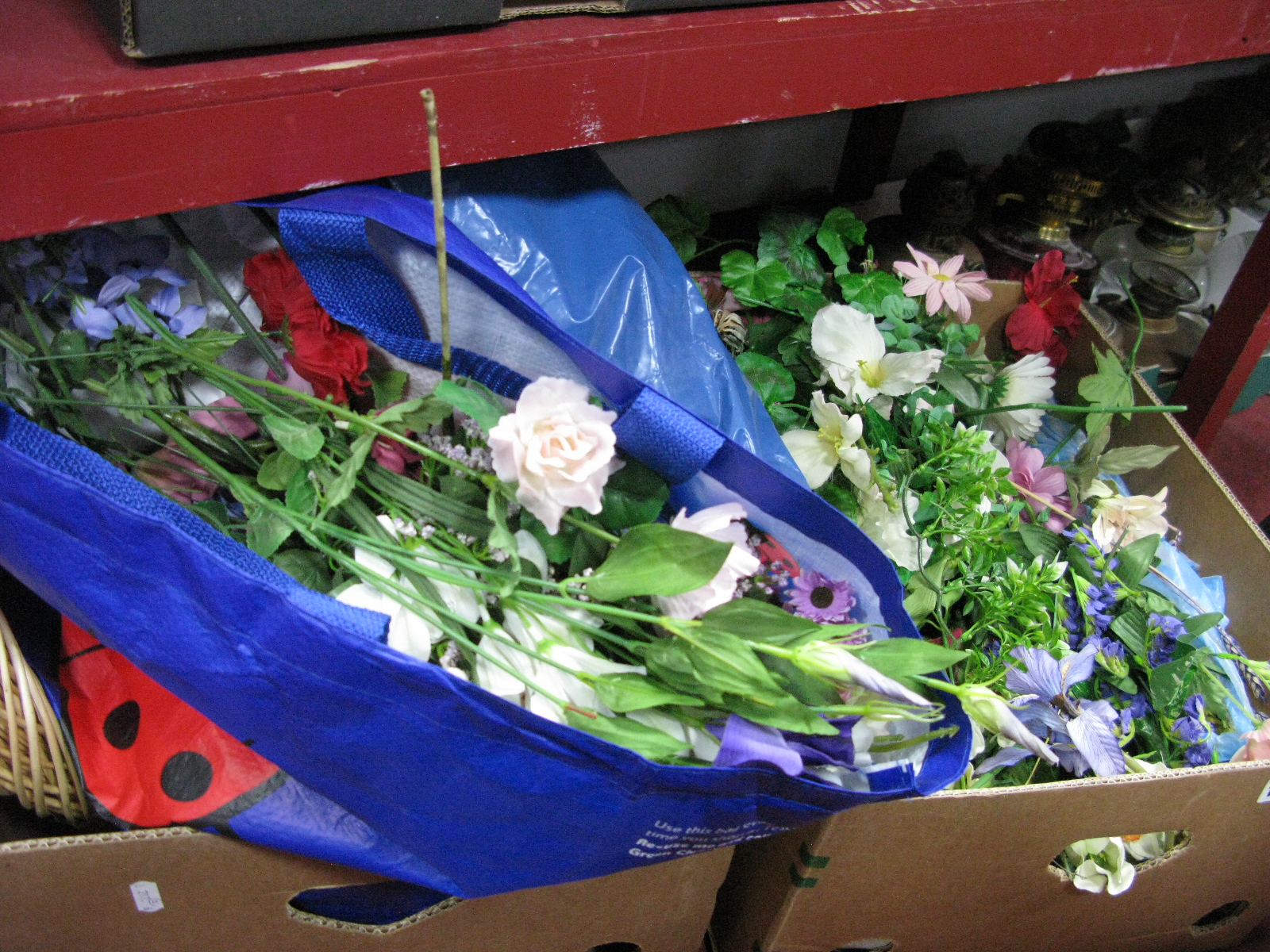 Lot 1086 - Quantity of Plastic Flowers, wicker displays:- Two Boxes